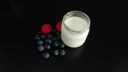 White Yogurt with Berries on a black tabletop