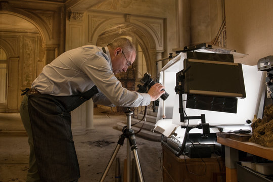 Artisan goldsmith taking pictures of a ring