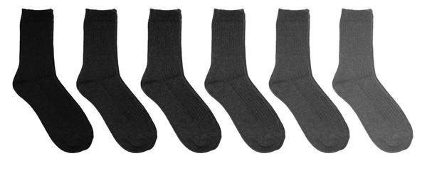 Grey socks of different colors. Socks in a row on a white background. Gray socks on a white background.