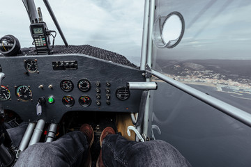 View of an instrument panel inside a cabin of a small plane