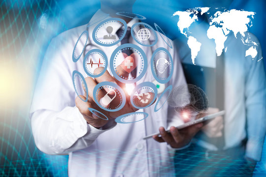 Doctor holding digital tablet with social network icons
