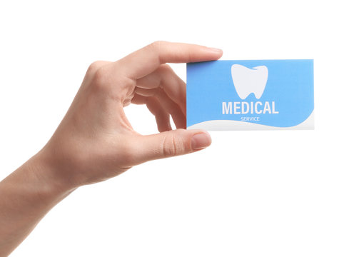 Woman holding business card isolated on white, closeup. Dental medical service