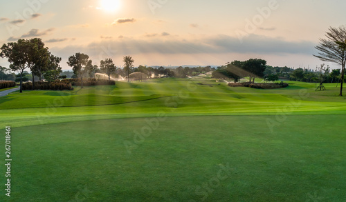 The beautiful green view of green grass and sand banker on golf