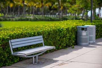Stock photo park bench and trash cans recycling bins
