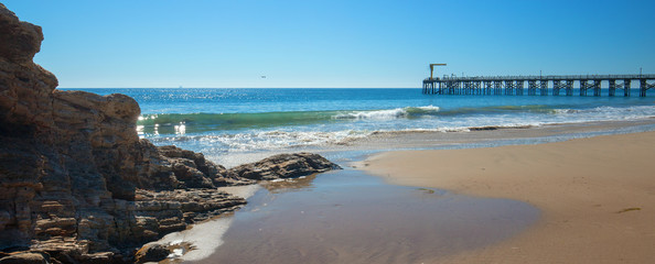 Fishing pier and boat hoist at Gaviota Beach on the central coast of California United States