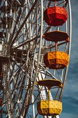 Foto op Aluminium Amusementspark Colourful ferris wheel in the amusement park Tibidabo on background of blue sky