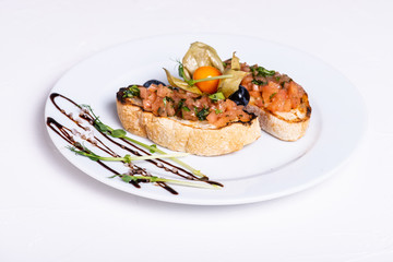 Delicious Italian antipasti bruschetta on white background. Close-up.