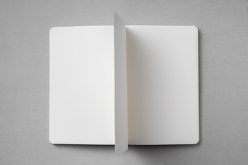 white notebook with turn page on grey background
