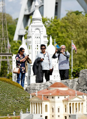 Tourists take pictures with their phones at the Mini Europe park in Brussels