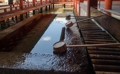 bassin for spiritual purification in Itsukushima Shrine. Is a Shinto shrine on the island of Itsukushima aka Miyajima. Japan