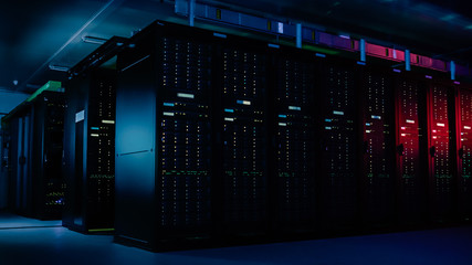 Descending Shot of Data Center With Multiple Rows of Fully Operational Server Racks. Modern Telecommunications, Cloud Computing, Artificial Intelligence, Database, Supercomputer Technology Concept. Wall mural
