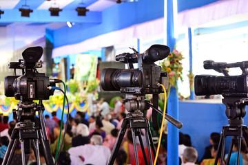 Video journalist capturing moving picture by camcorder in a event