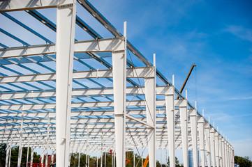 Fototapeta Skeleton of production steel hall in construction  obraz