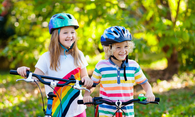Kids on bike. Children on bicycle. Child biking.