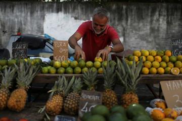 A vendor displays fruits at a street market in Rio de Janeiro