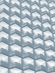 an abstract blue duotone image of large residential highrise building with geometric rows of balconies