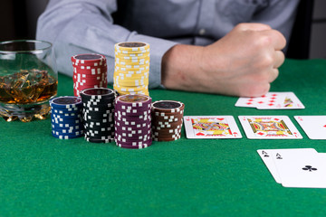 Lost in the poker game. Man beats his fist on the table