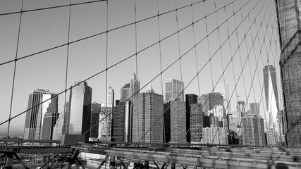 Manhattan buildings view from Brooklyn Bridge, black and white, New York, USA