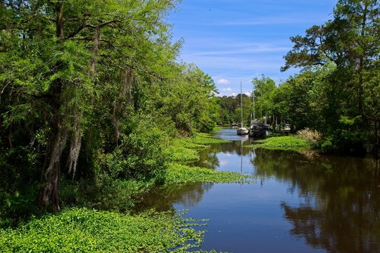 Boats parked along a canal on a sunny spring day in Bayou De Zaire located in Madisonville, Louisiana