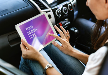 Person Using Tablet Mockup in a Car