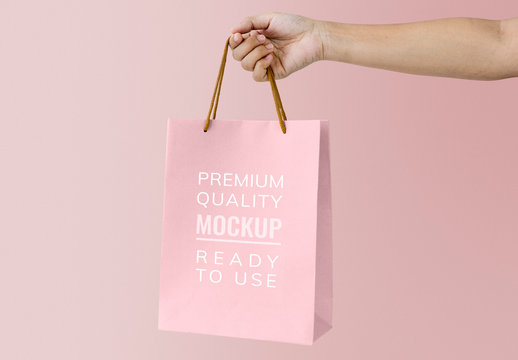 Hand Holding Pink Shopping Bag Mockup