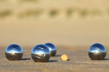 petanque balls on sandy beach