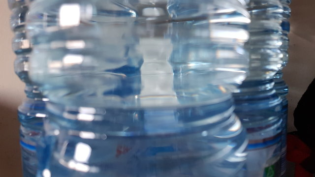 close up of plastic bottles full of water