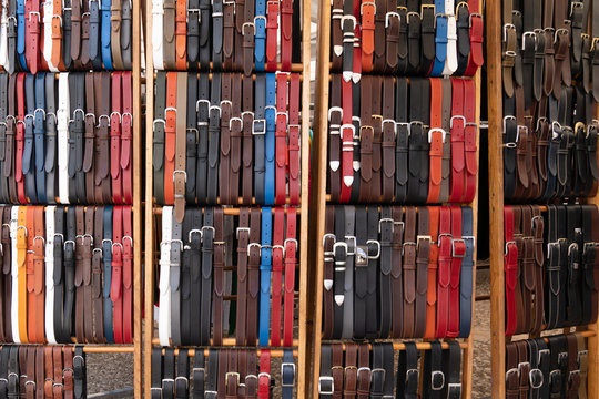 leather belts in artisan workshop for sale market background