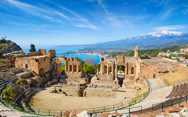 Ancient Greek theatre in Taormina on background of Etna Volcano, Italy Wall mural