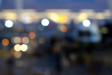 Blurry Abstract Bokeh Background: Airplane parked at departure gate at an airport.