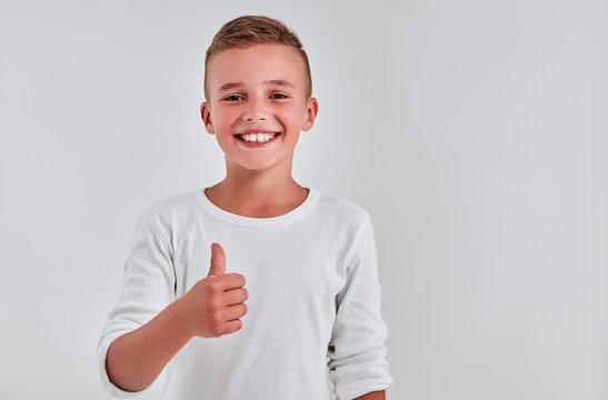 Cute boy on a gray background