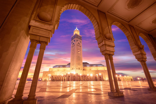 The Hassan II Mosque at sunset in Casablanca, Morocco. Hassan II Mosque is the largest mosque in Morocco and one of the most beautiful. the 13th largest in the world.