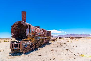 Rusty train in the famous train cemetry at Salar de Uyuni