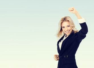 Photo of happy gesturing business woman