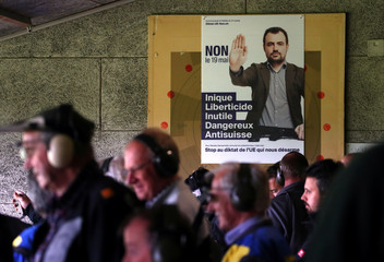 An advert asking to vote No to a May 19 referendum to tighten weapons ownership laws in line with EU steps is pictured during the Fribourg County 300m rifle final at the shooting range in Romont