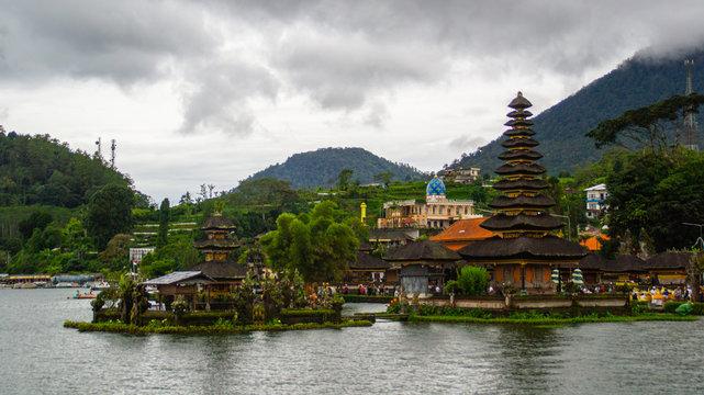 Moody scenic landscape view of Pura Ulun Danu Bratan, Hindu water temple on Bratan lake, tourist most popular attraction in Bali island, Indonesia.