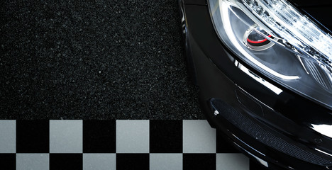 Top view of black modern car headlights with startinf line