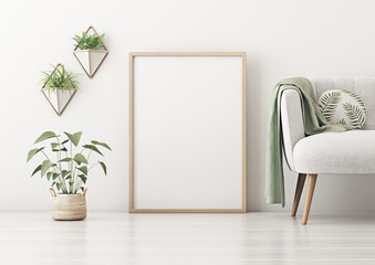 Poster mockup with vertical frame standing on floor in living room interior with gray sofa, round pillow, green plaid and plant in basket on empty white wall background. 3D rendering.