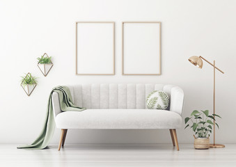 Poster mockup with two vertical frames on empty white wall in living room interior with gray velvet sofa, round pillow with tropical pattern, green plaid, lamp and plant in basket. 3D rendering.