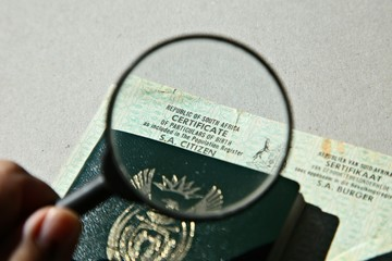 A South African birth certificate and Identity document. Home affairs concept image.