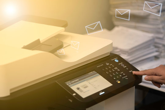 Multifunction machine scanning documents and sending to email.