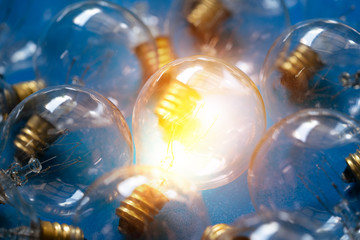 close up of light bulbs on a blue background,  idea concept