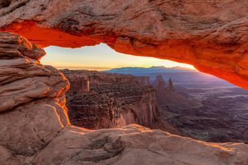 Orange sunrise glow on Mesa Arch