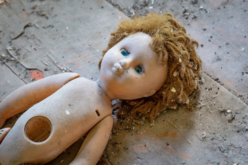 Abandoned child doll in a abandoned house in Belarus Chernobyl exclusion zone,