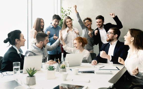 Business team celebrating success together on workplace