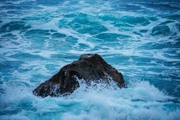Waves splashing on rock in Atlantic near Madeira island