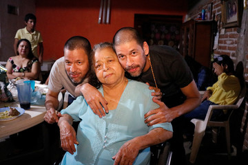 Jose Regino and his brother Simon Gonzalez, released from prison in Malaysia, where they were serving a sentence for drug trafficking conviction, pose for a photograph with their mother in Culiacan