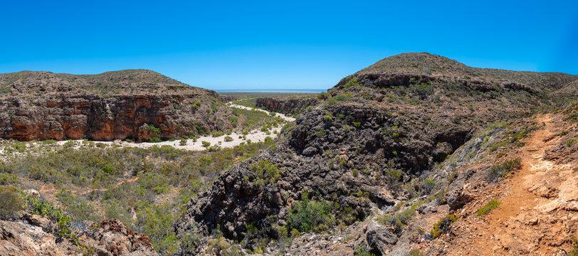 Mandu Mandu Gorge panorama with dry river bed leading into Indian Ocean at Cape Range National Park Australia