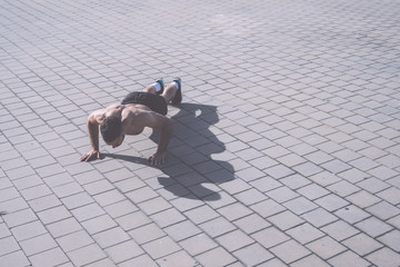 Picture of a athletic man doing push ups outdoors