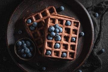 Yummy waffles made of cocoa with berry fruits